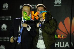 Tyrone Liu, CEO Consumer Business Group for Huawei Latin America displaying Huawei watch as a gift to Lionel Messi